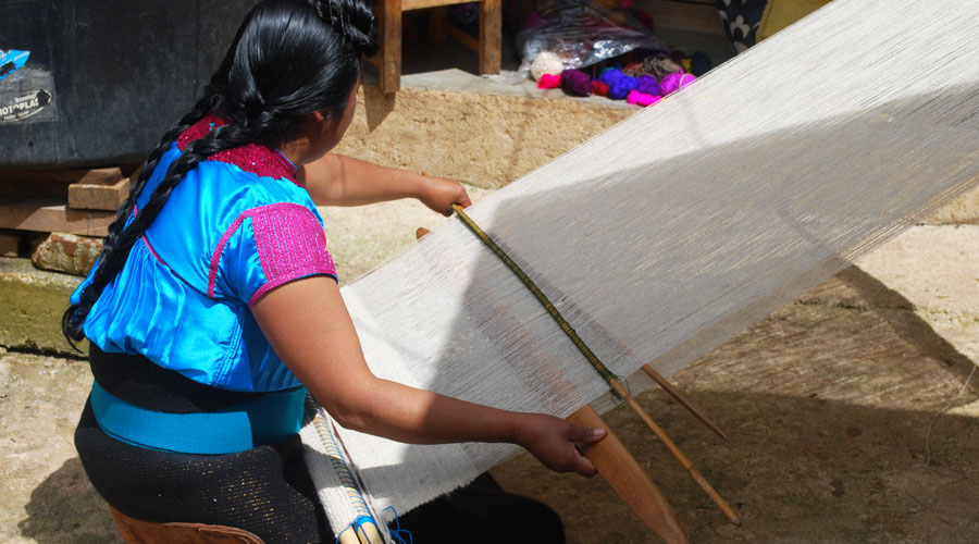Meridian | Our artisan partner demonstrates her process of weaving on a backstrap loom.