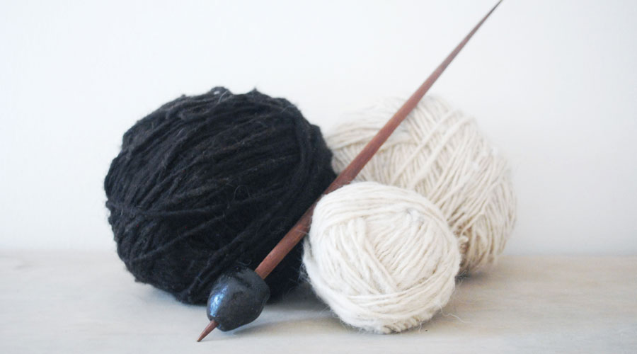 Meridian | These beautiful balls of natural, handspun wool were spun by our artisan partners on this traditional drop spindle. Every kilo of wool takes roughly 15 days to prepare – from washing to carding and spinning.