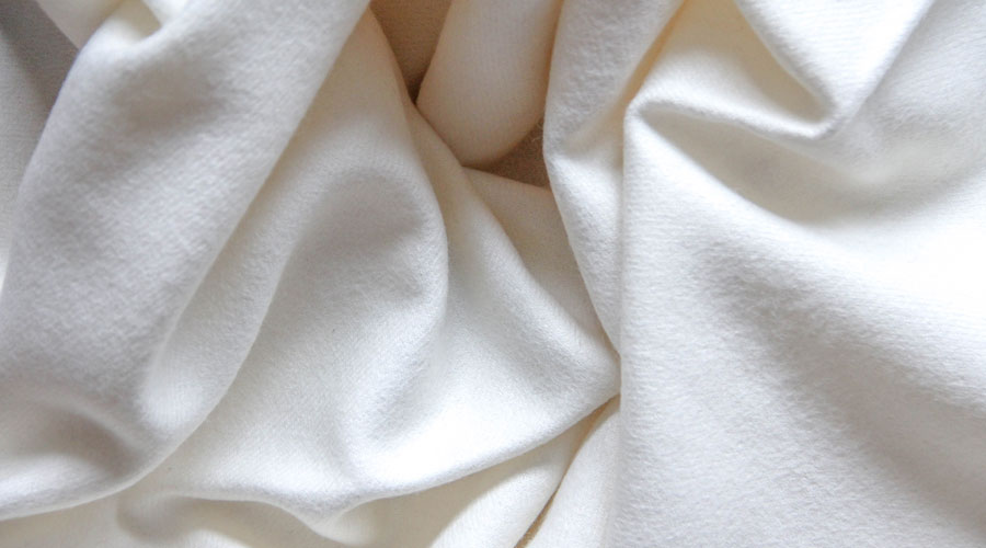Merididan | Our Baby Alpaca Throw Blanket is buttery soft.