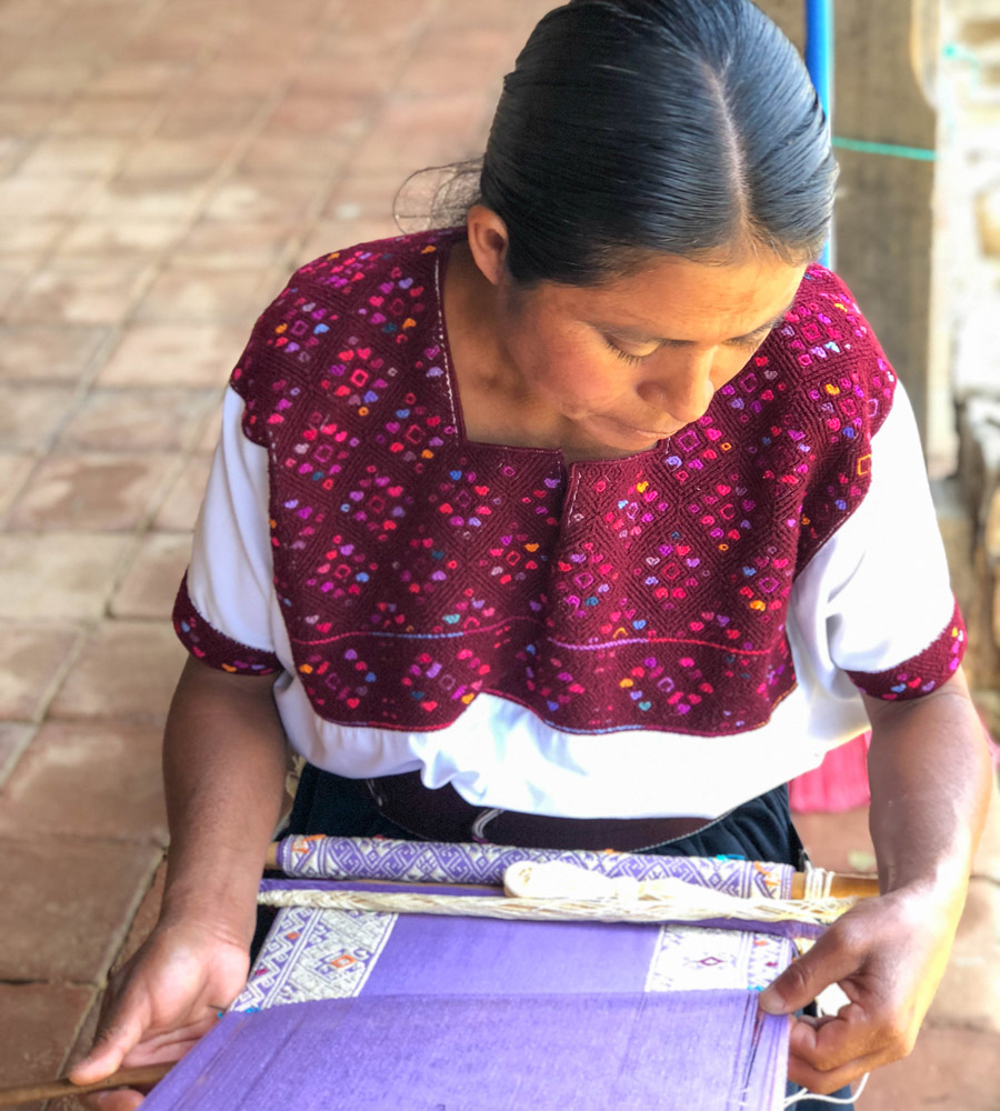 A Meridian artisan partner weaves a traditional textile on a backstrap loom in Southern Mexico. Photo taken by our founder, Ashley Viola. | Meridian
