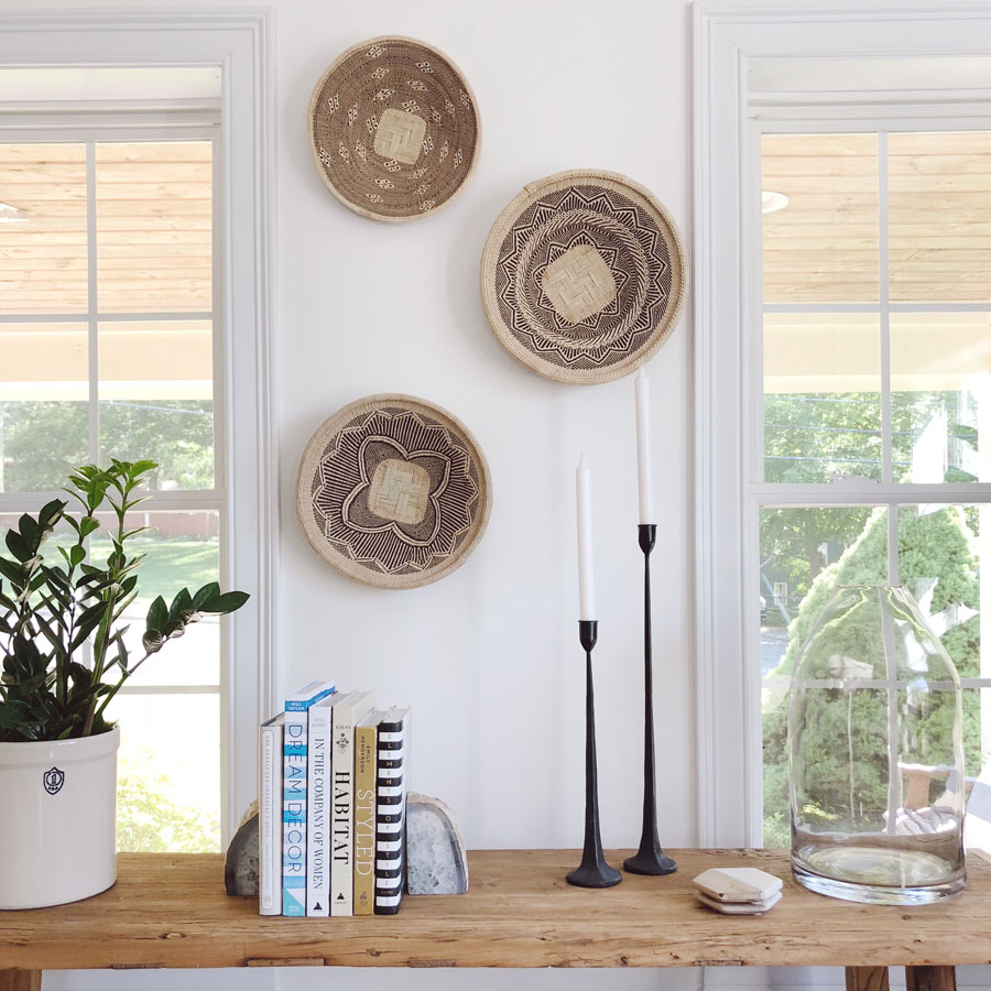 Four Easy Steps to Hang a Basket Wall - Take a cue from Meridian Collector Janis Snell, and mix and match designs of natural and neutral Woven Palm Baskets. | Meridian