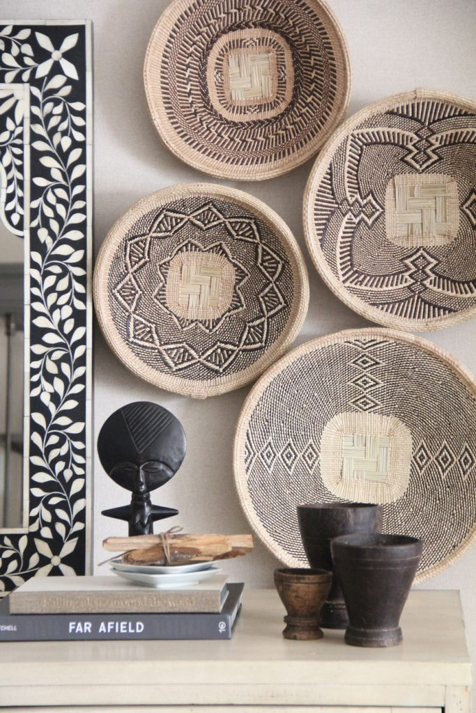 """Four Easy Steps to Hang a Basket Wall - Keep baskets """"hugging"""" each other rather than spreading them out too far. This will make your design feel more like a complete installation rather than something piece-meal. 