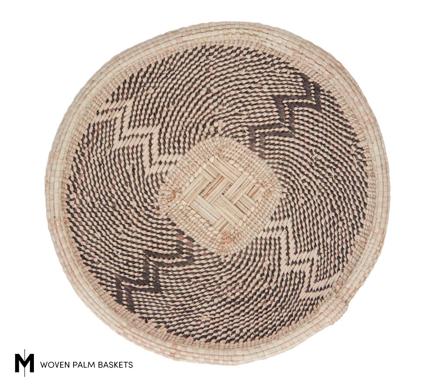 Meridian | The zig zag pattern emanating from the lattice center of the basket appears to be a reflection of a man's traditional apron garment.