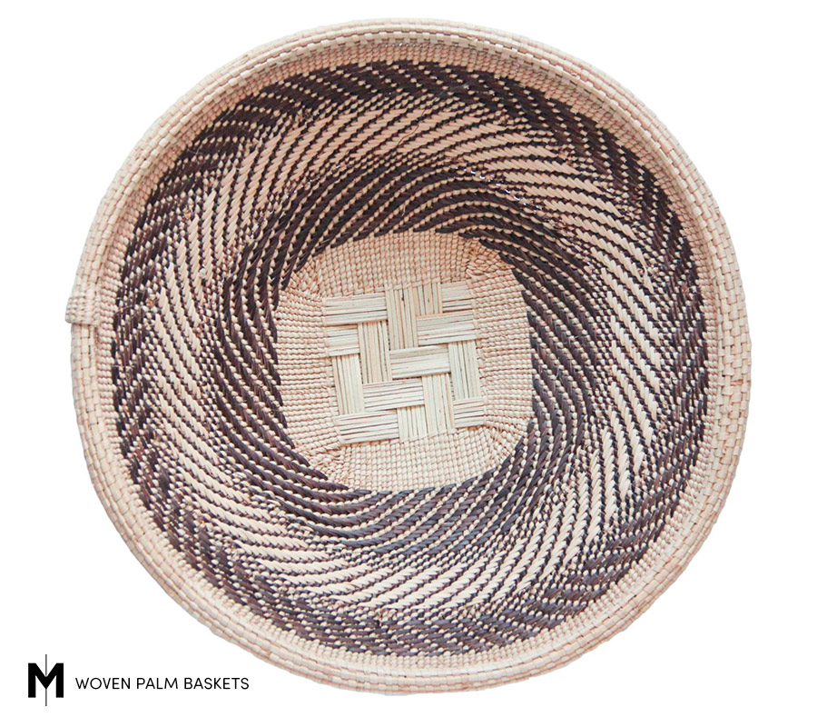 Meridian | The Puff Adder basket design references a venomous viper known for hiding in the tall grass.