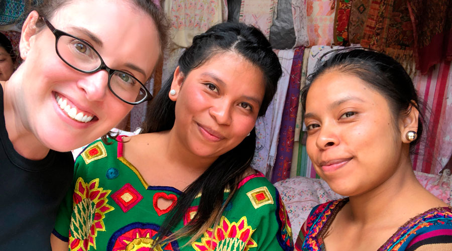 Meridian Founder Ashley Viola meets with Guatemalan partners selling vintage huipil textiles.