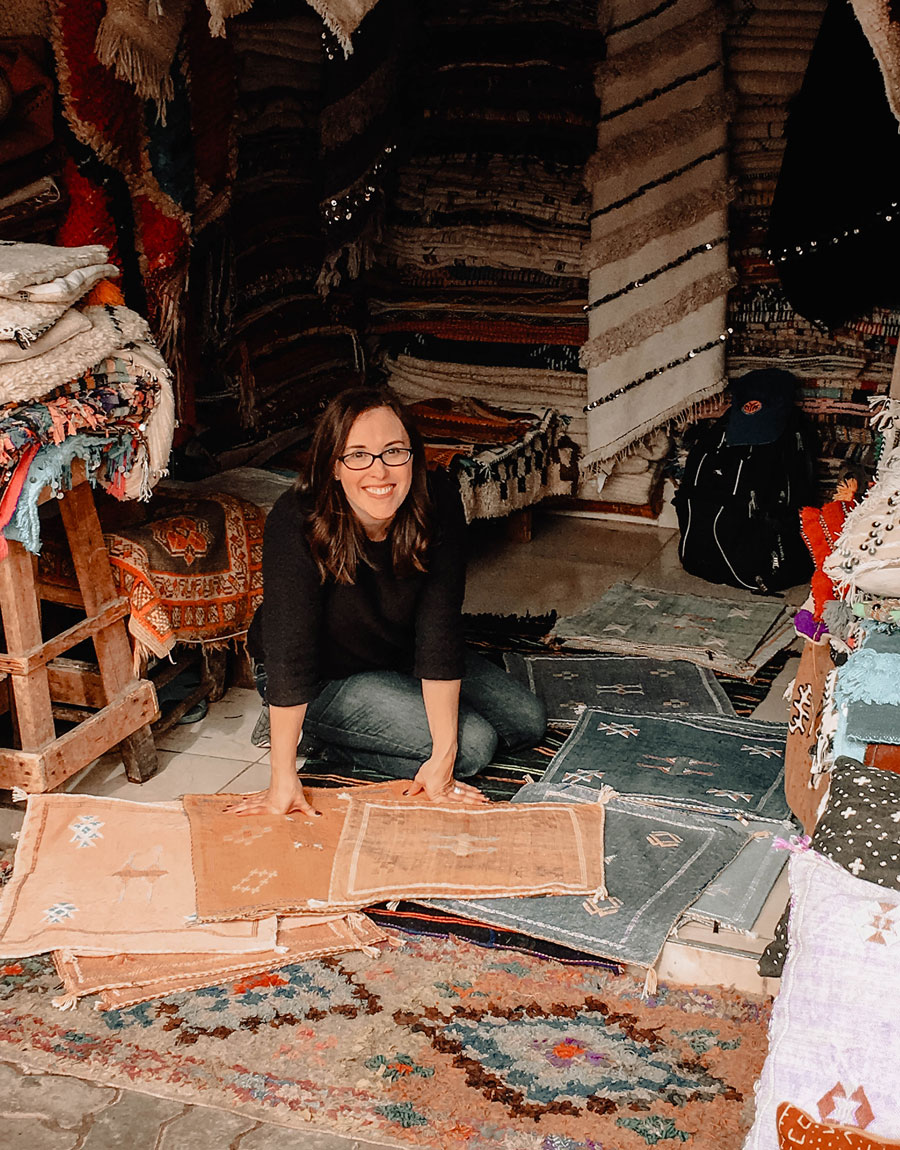 Meridian Founder Ashley Viola shops for textiles in the souks of Marrakech, Morocco.