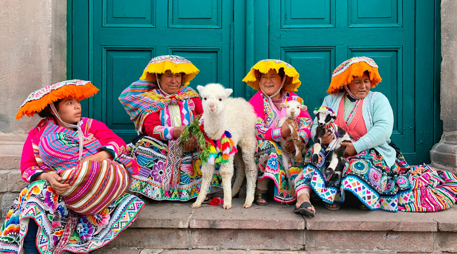 Meridian | A group of women in traditional dress show us their 2 month old baby alpaca and one week old baby sheep in Cusco, Peru.