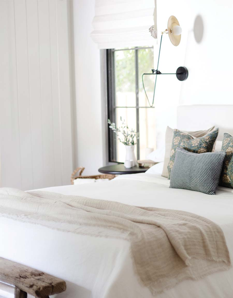 Nisha Linen Blanket on the foot of a bed -- fall home decor