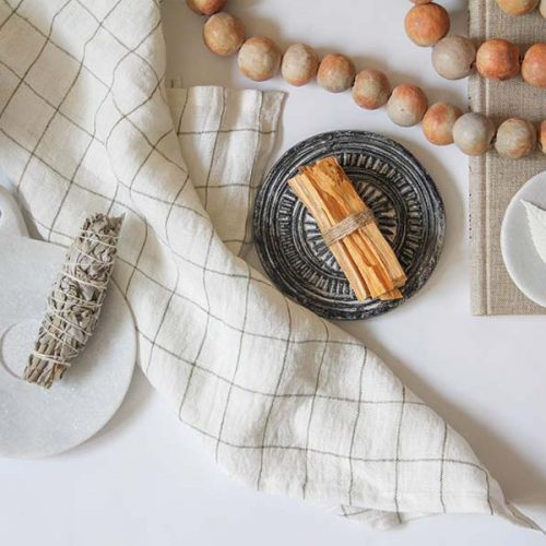 flat lay of the ritual collection featuring Palo Santo, Sage Bundle, and Sejnane Clay Beads