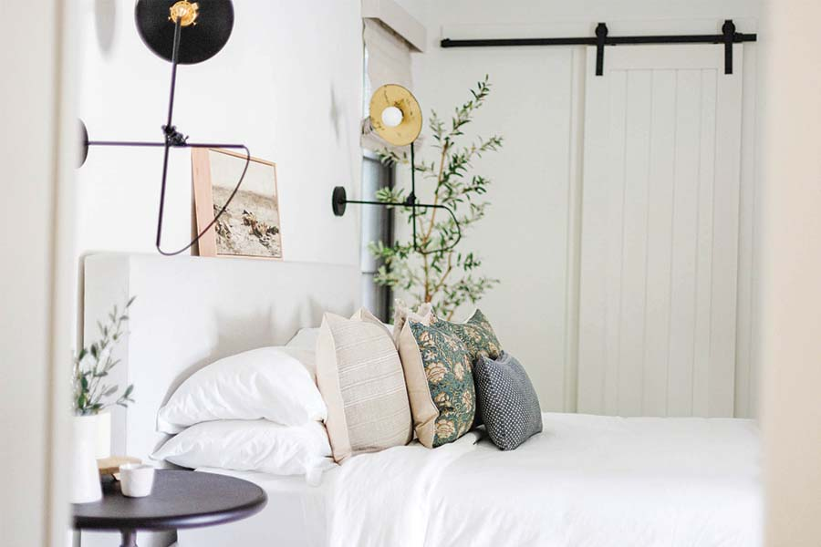 The Ritual Collection Pillows on a well made bed