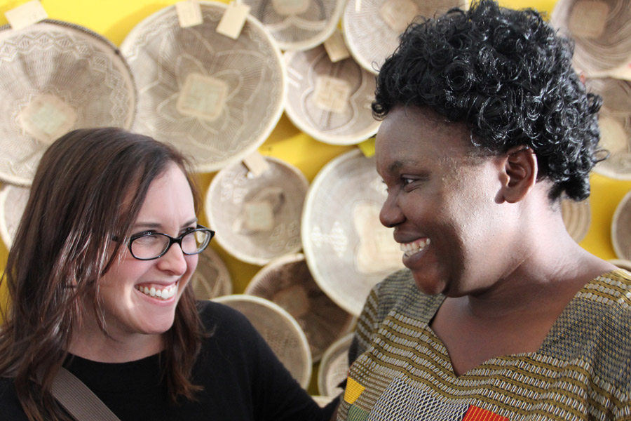 Meridian Founder Ashley Viola stands with one of our basket weavers from Zimbabwe.